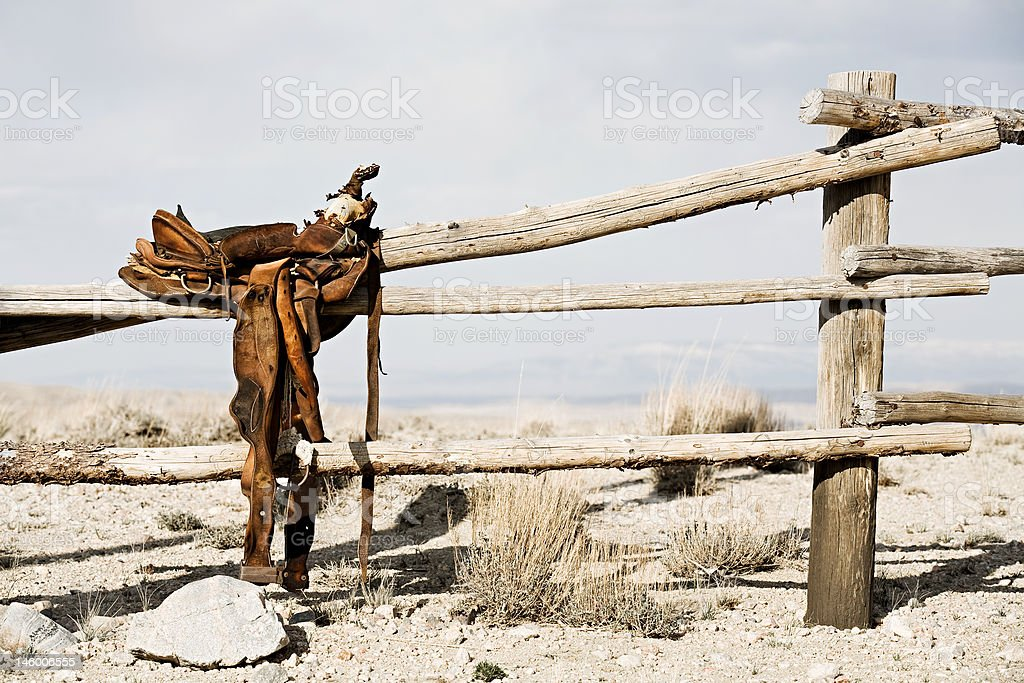 ranch - saddle on fence stock photo