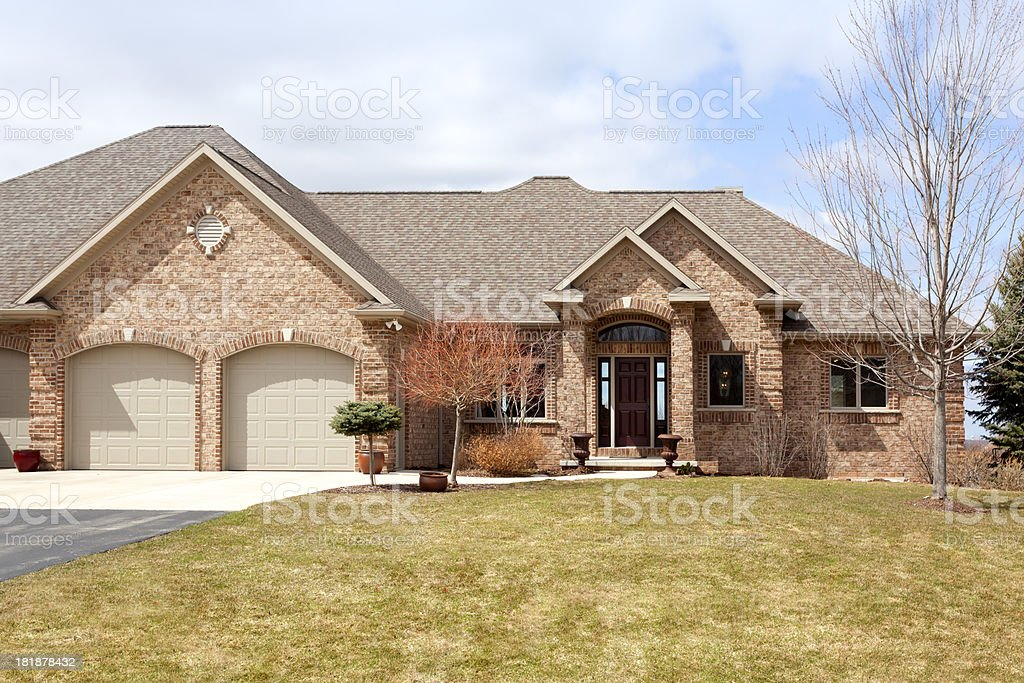 Ranch Style Brick Home With Gabled Roof royalty-free stock photo