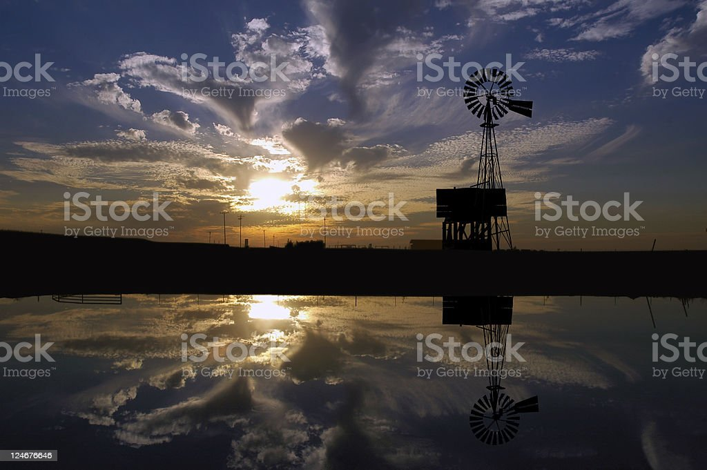 Ranch Windmill at Sunset stock photo