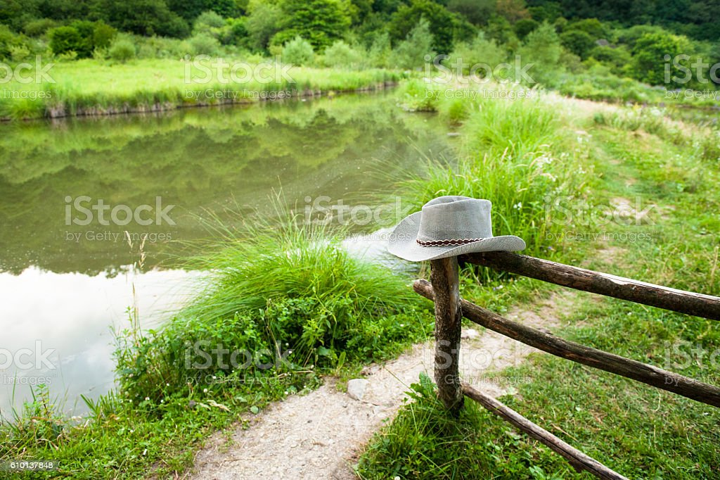 ranch with wooden fence and cowboy hat stock photo