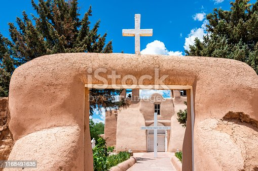 Ranchos de Taos St Francic Plaza and San Francisco de Asis church with cross and gate in New Mexico
