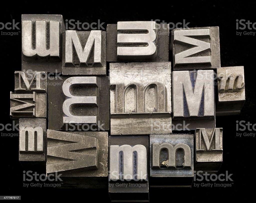 random letter M letterpress on black background royalty-free stock photo
