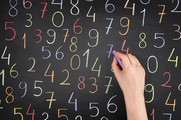 random numbers over blackboard - number stock photos and pictures