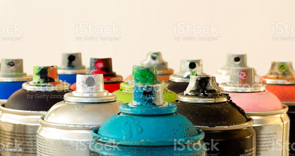 Range of aerosol cans used for graffiti macro stock photo