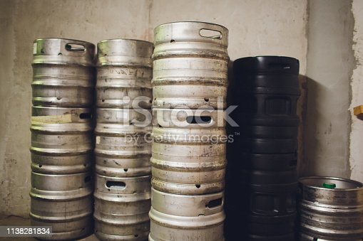 istock Range of stacked beer casks of kegs. 1138281834