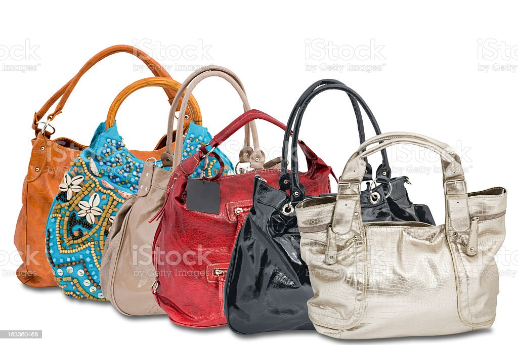 A range of women's handbags in various colors and styles royalty-free stock photo