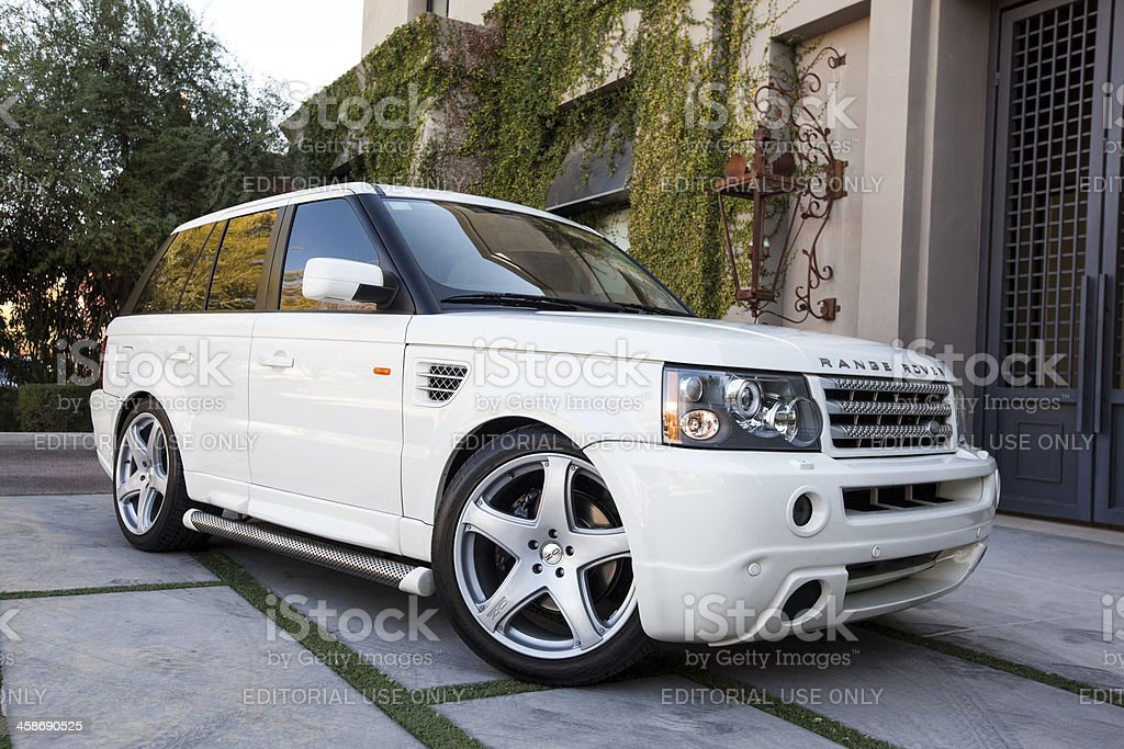 Range Rover 2006 Scottsdale, United States - January 31, 2012: A photo of a parked white Range Rover SUV. The Range Rover although designed for off road use, has become popular as a luxury street vehicle. Building Exterior Stock Photo
