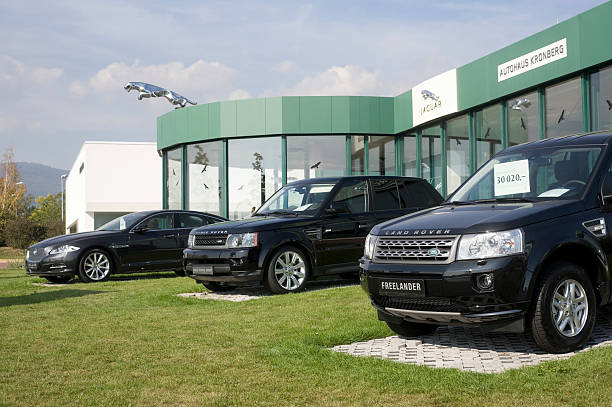 Range Rover and Jaguar outside a car retailer`s building Kronberg, Germany - October 3, 2011: Range Rover Sport, a Land  Rover and a Jaguar XJ outside a car retailer`s building. Jaguar and Land Rover are British Car Manufacturers. Jaguar Cars Ltd. is a manufacturer of  luxury cars. Today Land Rover and Jaguar arewholly owned subsidiaries of the Indian Tata Motors Ltd.s. jaguar xj stock pictures, royalty-free photos & images