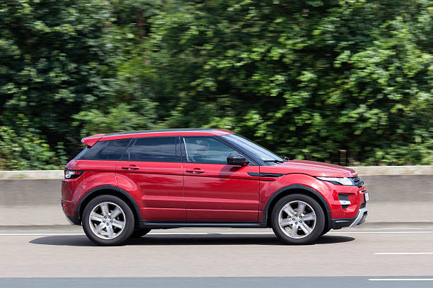 Range Rover Evoque on the road Frankfurt, Germany - July 12, 2016: Range Rover Evoque on the highway in Germany range rover stock pictures, royalty-free photos & images