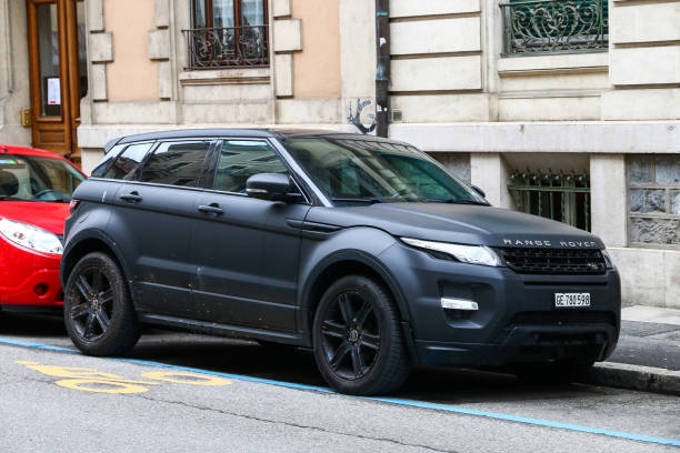 Range Rover Evoque Geneva, Switzerland - March 13, 2019: Luxury 4x4 vehicle Range Rover Evoque in the city street. range rover stock pictures, royalty-free photos & images