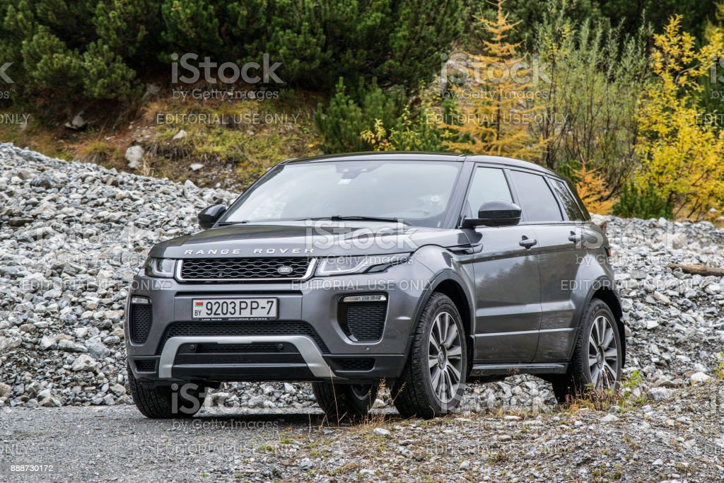 Range Rover Evoque Davos, Switzerland - October 3, 2017: Range Rover Evoque travels across Switzerland and European Alps to northern Italy. Photo taken in the Alps near Davos and on Umbrail pass. Range Rover Evoque is a compact SUV with a high functionality and great potential for long road travels. Austria Stock Photo