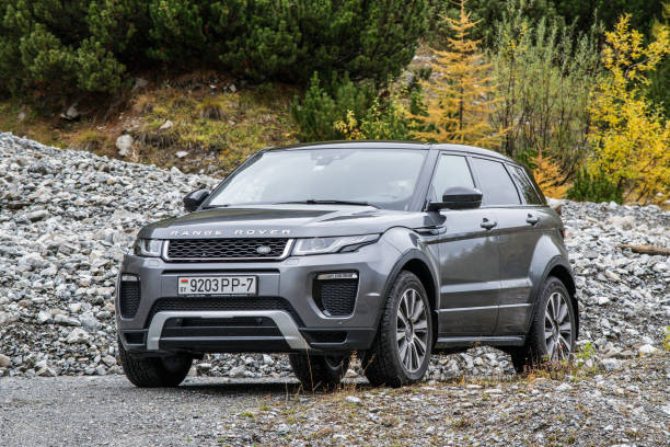 Range Rover Evoque Davos, Switzerland - October 3, 2017: Range Rover Evoque travels across Switzerland and European Alps to northern Italy. Photo taken in the Alps near Davos and on Umbrail pass. Range Rover Evoque is a compact SUV with a high functionality and great potential for long road travels. range rover stock pictures, royalty-free photos & images