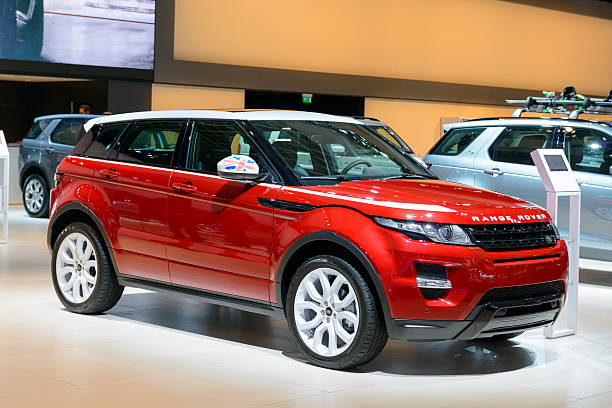 Range Rover Evoque SUV Brussels, Belgium - January 15, 2015: Range Rover Evoque SUV luxury compact SUV car on display during the 2015 Brussels motor show. People in the background are looking at the cars. range rover stock pictures, royalty-free photos & images