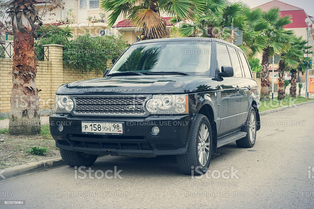 Range Rover parked on the street. stock photo