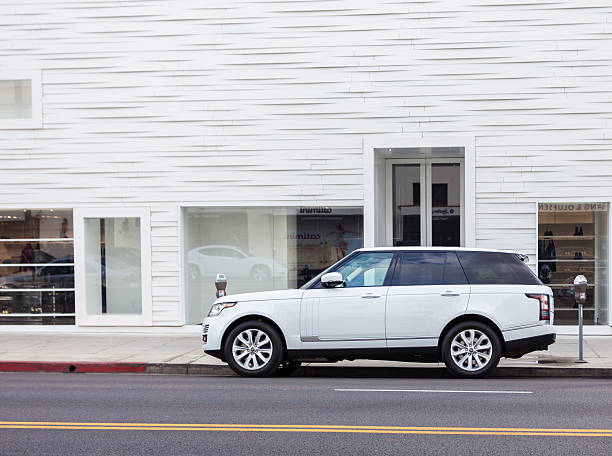 Range Rover Beverly Hills, USA - February 4, 2014: A new 2014 Range Rover parked in Beverly Hills. The Range Rover is a large luxury four-wheel drive sport utility vehicle (SUV) produced by British car maker Land Rover range rover stock pictures, royalty-free photos & images