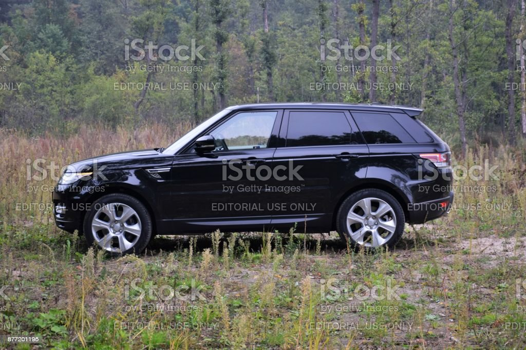 Range Rover Sport HSE Hybrid on the grass stock photo