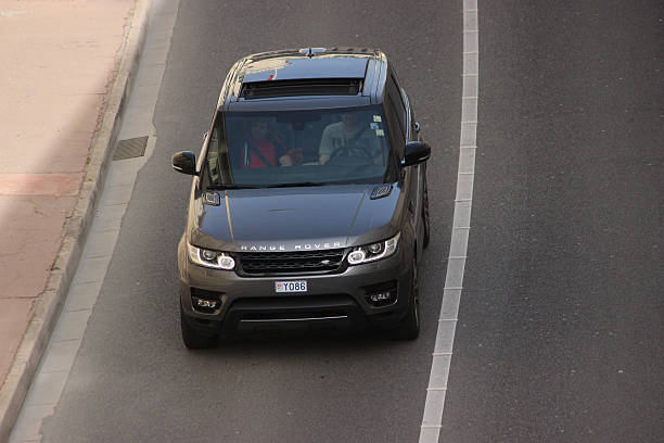 Range Rover Sport in Monte-Carlo, Monaco Monte-Carlo, Monaco - April 6, 2016: Aerial view of a Land Rover Range Rover Sport SUV in the Streets of Monaco. Man Driving a Black Range Rover Sport in the South of France range rover stock pictures, royalty-free photos & images