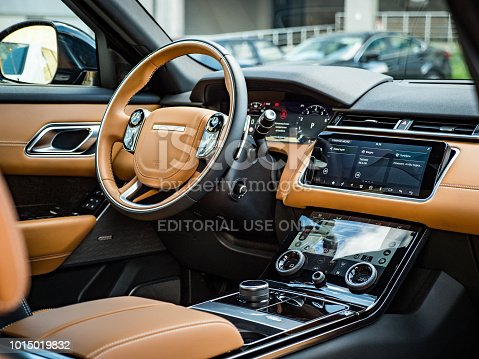 """Minsk, Belarus - August 7, 2018: Photo of Range Rover Velar's optional high-definition 12.3"""" Interactive Driver Display. Display features ultra sharp resolution delivering smooth curves and sharp edges. Velar's driver can interact directly with the display and can control media, make and receive phone calls and select features to populate chosen view."""