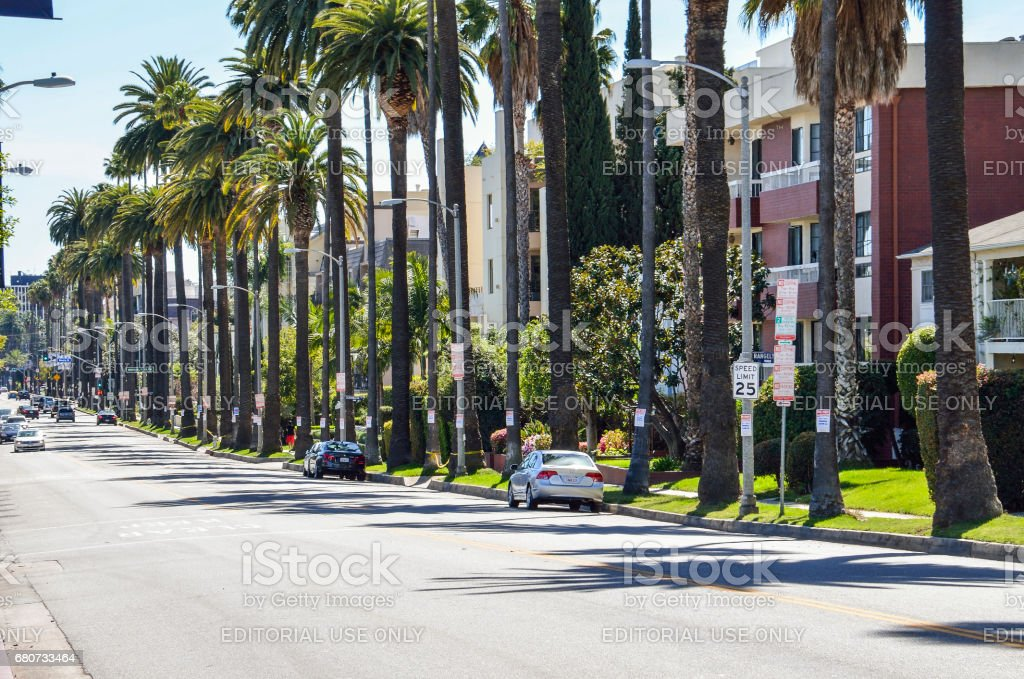 Rangely Beverly street in downtown LA with residential houses and palm trees stock photo