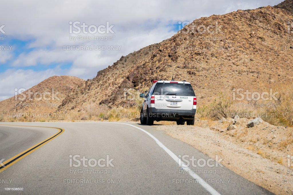 March 17, 2018 Joshua Tree NP / CA / USA - Ranger car stopped on the...