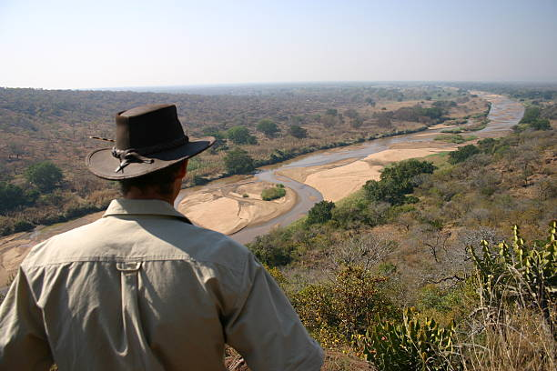 Ranger checking out amazing view Guy checking out amazing view in Africa park ranger stock pictures, royalty-free photos & images