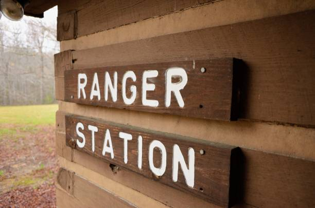 Ranger station sign on cabin Close up of ranger station sign on cabin building in public state recreation area park ranger stock pictures, royalty-free photos & images