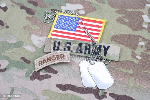 istock US ARMY ranger tab, flag patch,  with dog tag on camouflage uniform 1019026064