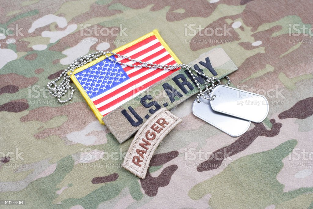 US ARMY ranger tab, flag patch, with dog tag on camouflage uniform stock photo