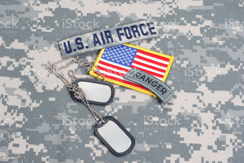 US AIR FORCE ranger tab with blank dog tags on camouflage uniform stock photo