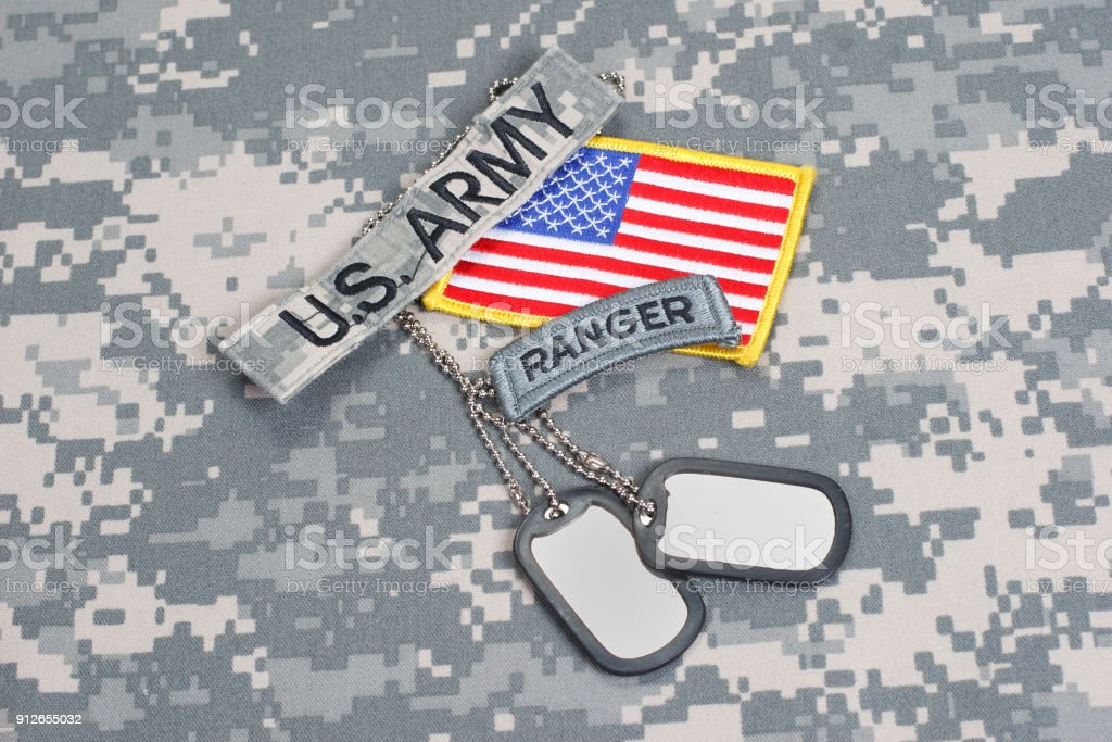 US ARMY ranger tab with blank dog tags on camouflage uniform stock photo