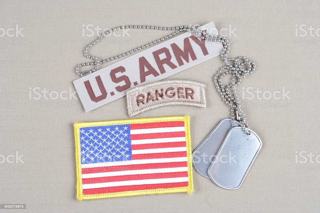 US ARMY ranger tab with dog tag and flag patch stock photo