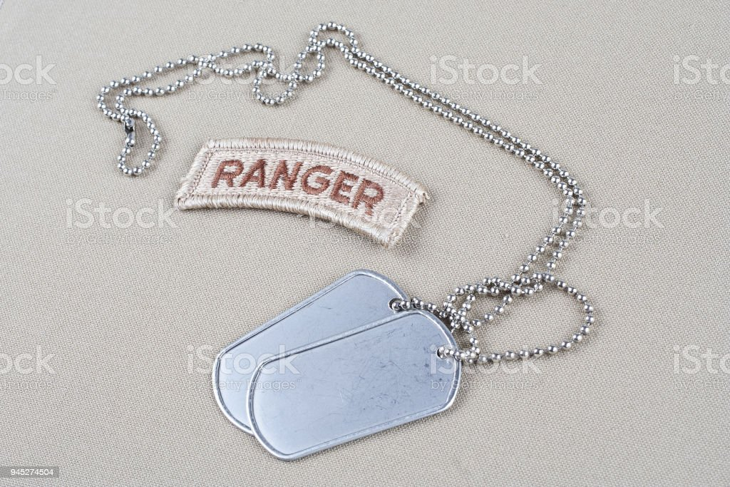 US ARMY ranger tab with dog tag stock photo