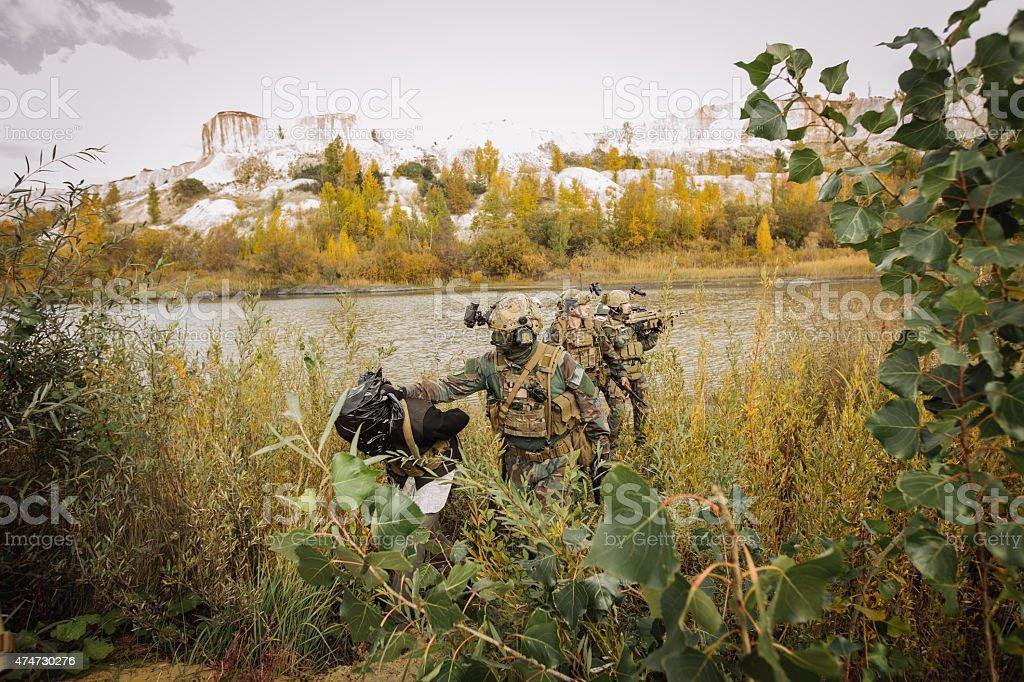 Rangers are captured terrorist in place evacuation stock photo