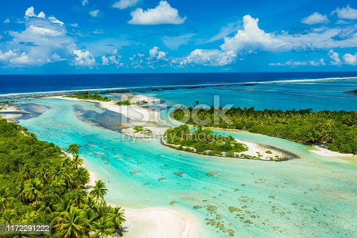 Rangiroa aerial drone video of atoll island motu and coral reef in French Polynesia, Tahiti. Amazing nature landscape with blue lagoon and Pacific Ocean. Tropical island paradise in Tuamotus Islands.