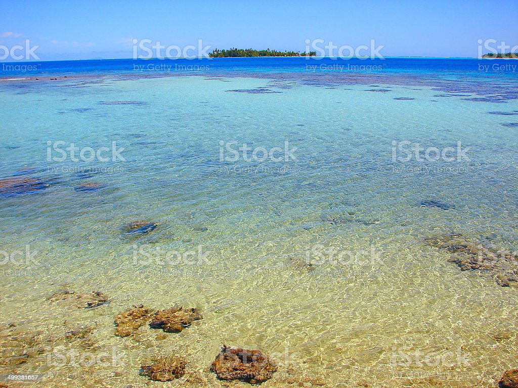 Rangiroa blue lagoon motu from turquoise waters, Polynesia, Tahiti royalty-free stock photo
