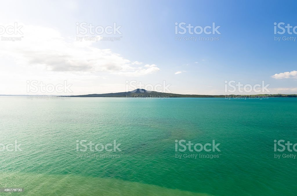 Rangitoto Island view from Mission Bay in Auckland,New Zealand. stock photo