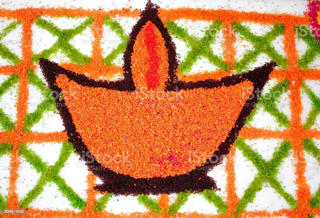 Rangoli of a lamp (diya) stock photo