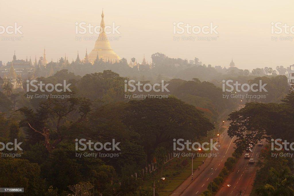 Rangoon Shwedagon pagoda and street  just after sunrise royalty-free stock photo