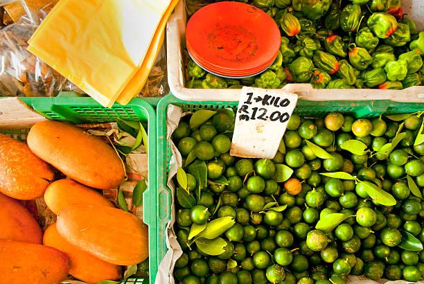 Rangpur limes, mangoes and chilis stock photo
