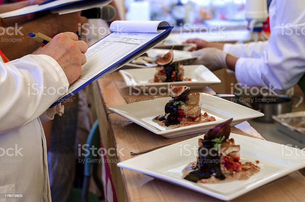Ranking food at a contest Ranking food at a contest Caucasian Ethnicity Stock Photo