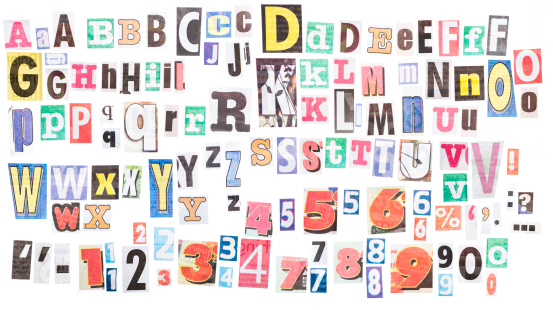 Loads of letters clipped from newspapers. There are several variants of each letter,  plus numerals and punctuation.