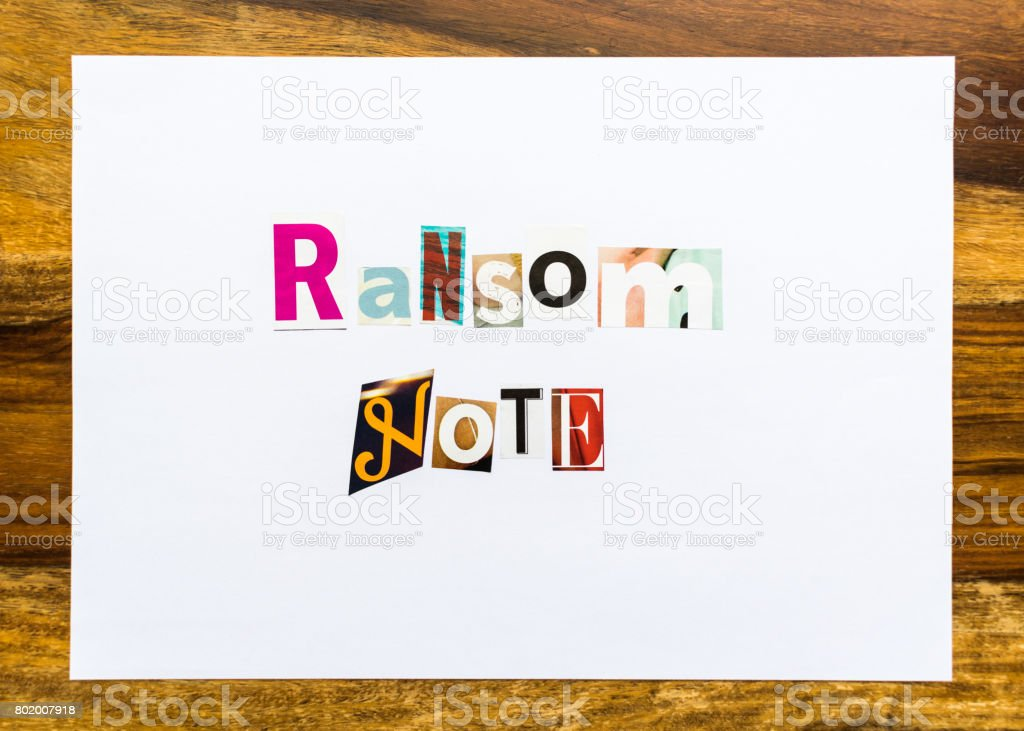 Ransom Note - note on desk stock photo