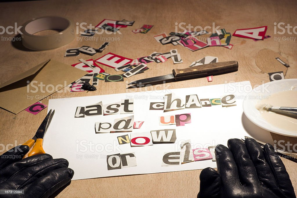 Ransom note style debt collection threat. royalty-free stock photo
