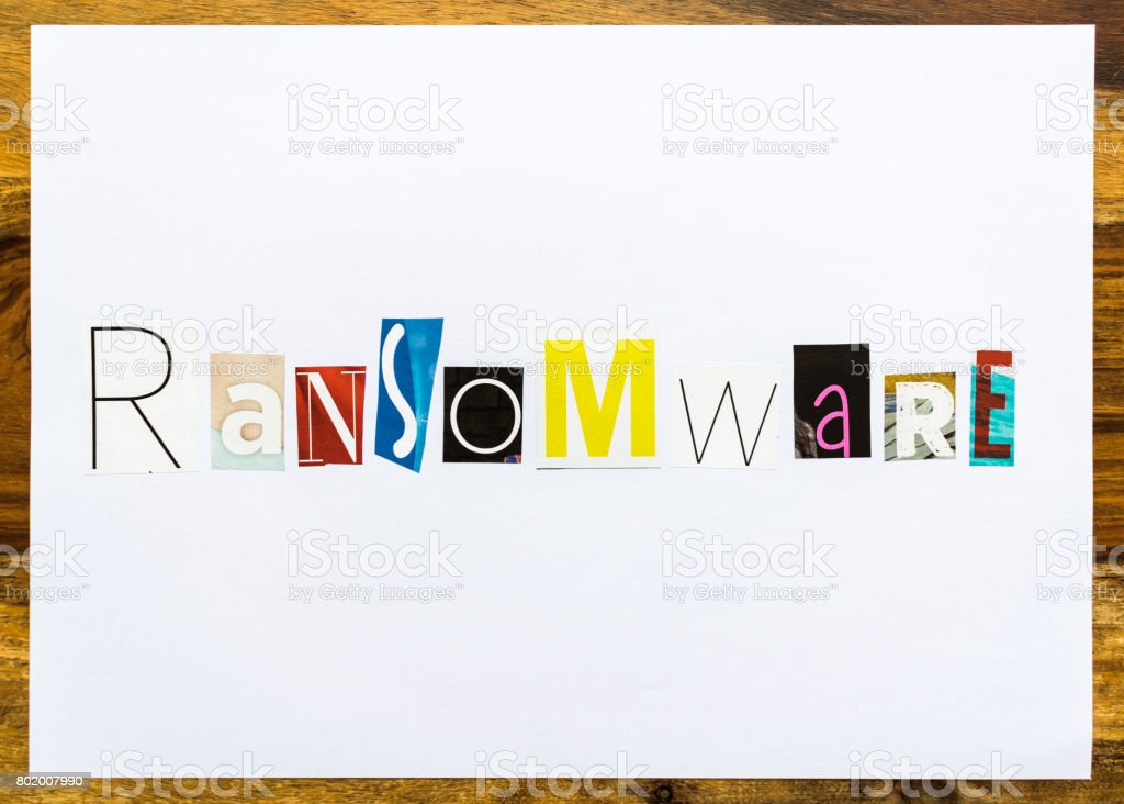 Ransomware - note on desk stock photo