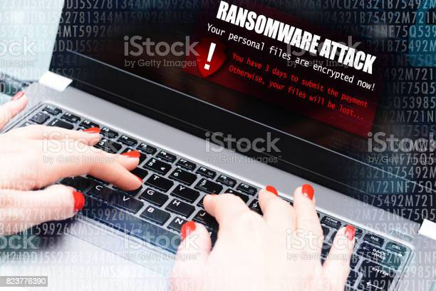 Ransomware Virus Attack Message Blocking A User To Access Data On Computer Stock Photo - Download Image Now