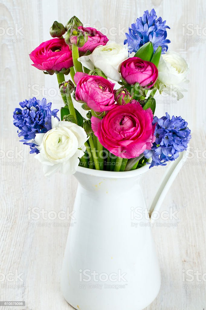 ranunculus and hyacinth flowers in a pitcher royaltyfree stock photo