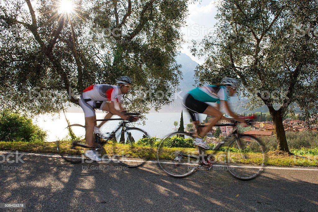 raod cycling motion blur - blurred road cycling stock photo