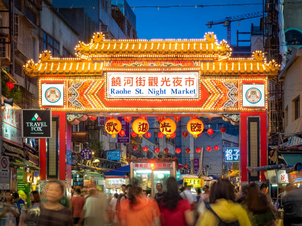 Raohe Street Night Market in Taipei City. Taipei, Taiwan - Aug 1, 2018: Tourists are shopping around the famous Raohe Street Night Market. night market stock pictures, royalty-free photos & images