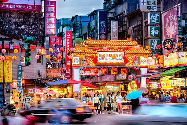 Raohe Street Night Market in Taipei - Taiwan. Entrance of Raohe Street Night Market in Taipei. night market stock pictures, royalty-free photos & images