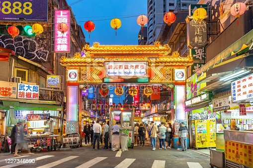 Taipei, Taiwan - March 29, 2020 : night view of the entrance of Raohe Street Night Market, one of the oldest and most famous night markets in Taipei, Taiwan.